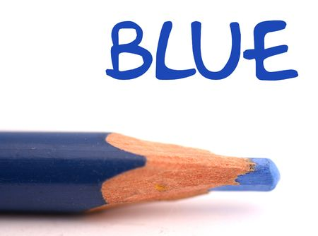 closeup of blue pencil crayon with the word blue above it on white background