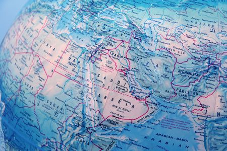 focused: closeup of World globe focused on middle east with blue background Stock Photo