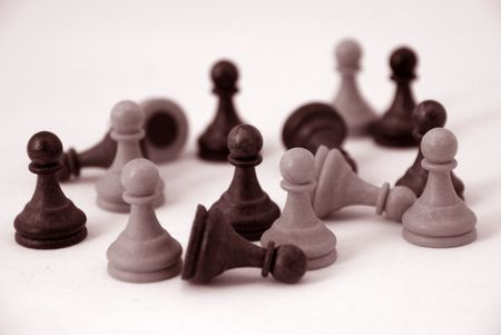 pawns standing and fallen photo