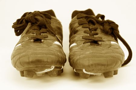 cleats: cleats head on in sepia Stock Photo