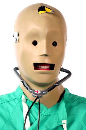 Close-up of crash test dummy in doctors scrubs 스톡 콘텐츠