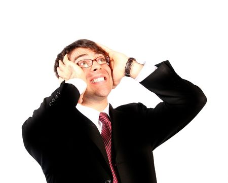 anguish: business man wearing glasses with hands on head looking up in anguish