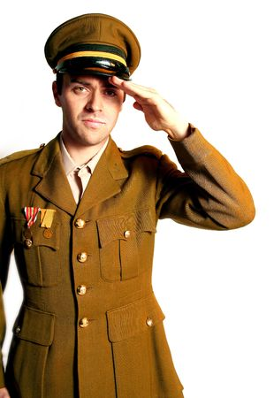 man in military field uniform with hat saluting photo