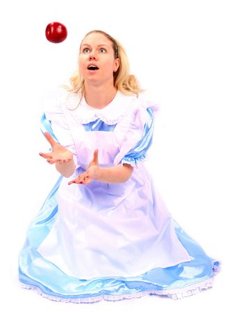 young attractive beautiful and shocked woman or girl in blue dress catching a falling apple in excitement