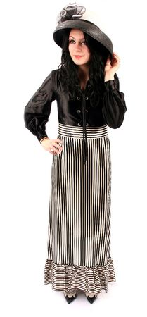 beautiful woman from the 50's fifties with a fashionable black stripped skirt and black blouse and fancy hat