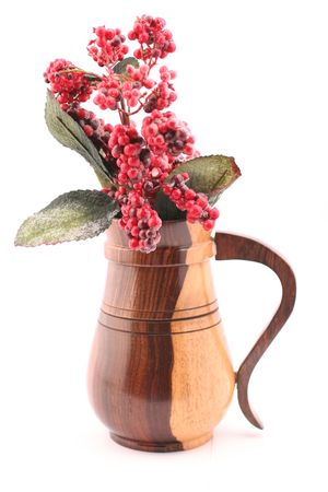 sleek: red frosted cherries in a wooden jug