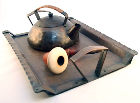 Tea Pot And Pipe On A Vintage antique Tray photo