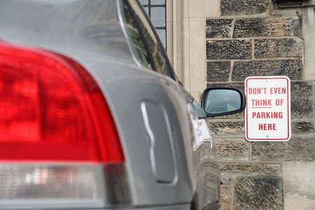 assume: dont even think about parking here warning Stock Photo