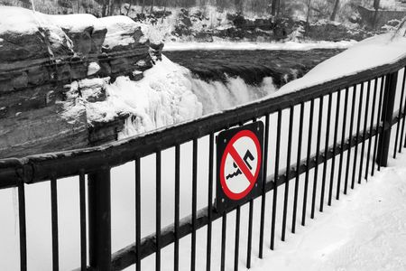 no swimming: cold snow bank with a no swimming allowed sign