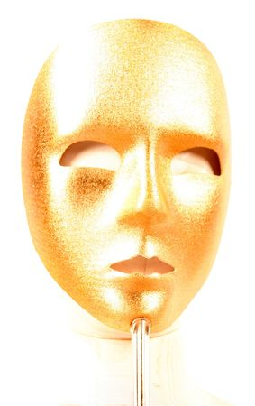 pretense: golden mask on a stick for a masquerade ball with a female mannequin