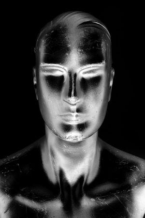 futuristic manikin man in silvery shadows of black and silver