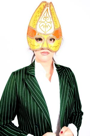 woman wearing fancy yellow and gold studded mask with green suit on