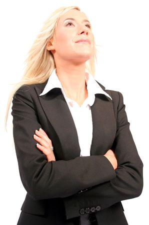 Beautiful blonde business woman with arms crossed looking up
