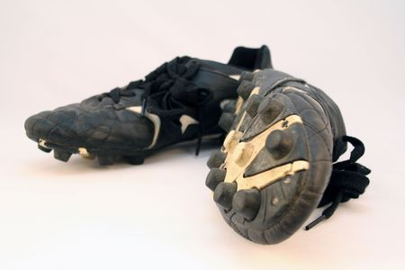 old soccer or football sport boots or sports cleats photo