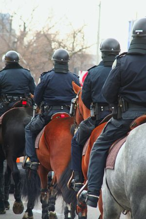 gripe: riot or protest soldiers of a police state policemen on horse back