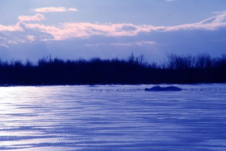 cold barren blue waste land of freezing arctic temperatures and frozen ice and snow