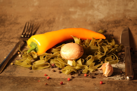 peppery: green pasta with ingredients on stone background Stock Photo