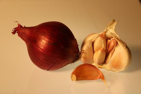 Fresh garlic and onion on white background Stock Photo