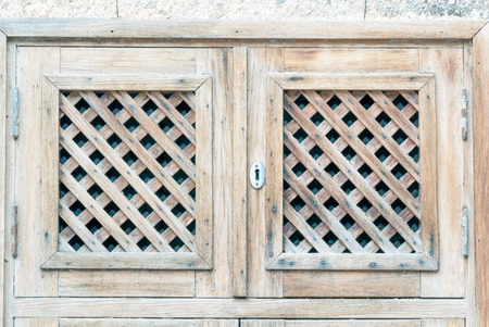 latticework: Door of a country house with latticework and keywhole Stock Photo