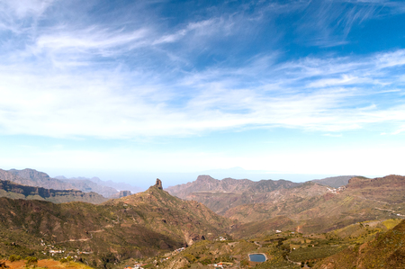 grand canary: A panoramic view of the south wet basin of Grand Canary island, with Bentayga rock in the middle and volcano Teide in the background