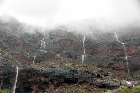 grand canary: Waterfalls after a storm over the Tasarte village in Grand Canary island Stock Photo