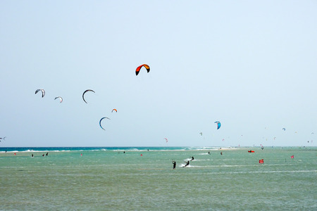 A shot of many kitesurfers and windsurfers in Sotavento Beach, Fuerteventura island Foto de archivo