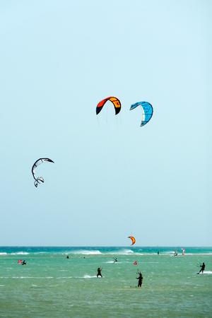 windsurfers: A shot of many kitesurfers and windsurfers in Sotavento Beach, Fuerteventura island Stock Photo