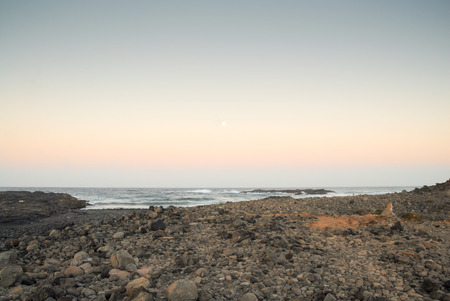 grand canary: A shot of the moon over a beach in Grand Canary island