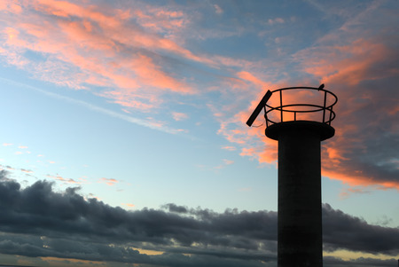 grand canary: A shot of a bird on a watchtower in the dock of San Cristóbal, Grand Canary Stock Photo