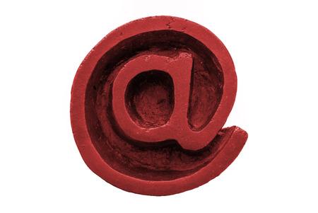 arroba: A macro and isolated shot of a bronze computing arroba symbol (at sign) Stock Photo