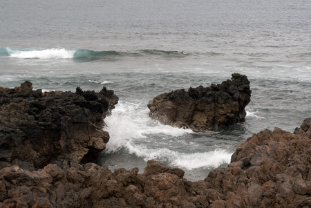 breaking in: A shot of the waves breaking in a reef causing an explosion of drops and foam