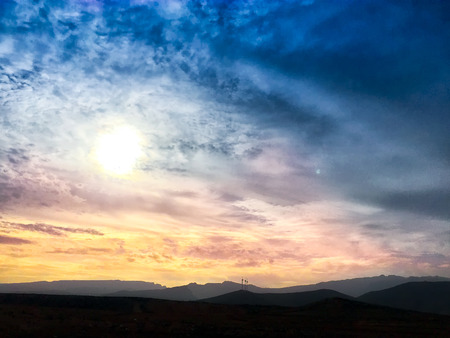 A shot of a beautiful sunset over the mountains in a cloudy day at the town of Vecindario (Grand Canary, Canary islands) Stock Photo