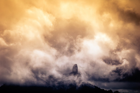 grand canary: A view of the Nublo Rock surrounded by clouds at sunset in the highlands of Grand Canary island Stock Photo