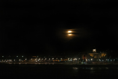 A shot of the November 14, 2016 Supermoon over Las Canteras Beach and the Alfredo Kraus Auditorium in Las Palmas de Gran Canaria