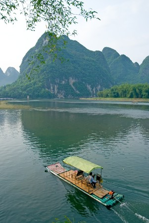 Bamboo raft on the Li river near Yangshuo, Guanxi province, China photo