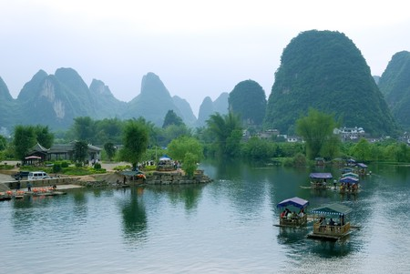 Bamboo raft at the Ulong river near Yangshuo, Guanxi province, China photo