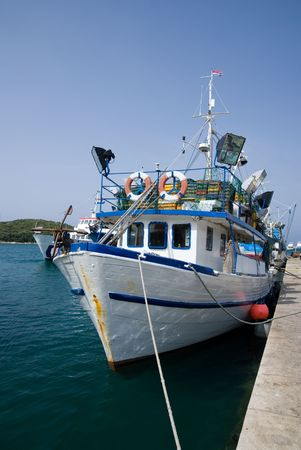 Fishing boat in the port of Istrian town, Croatia photo