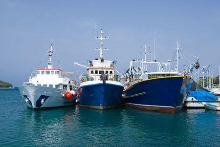 Three fishing boats in the port of Vrsar, Istria, Croatia photo