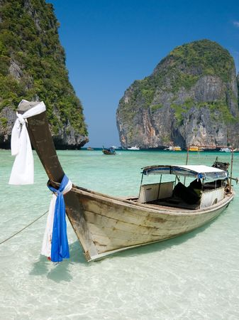 Traditional longtail boat in the famous Maya bay of Phi-phi Leh island, Krabi province, Thailand  photo