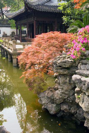 Pond and pavilion at Yu Yuan (The Garden of Peace and Comfort), Shanghai, China photo
