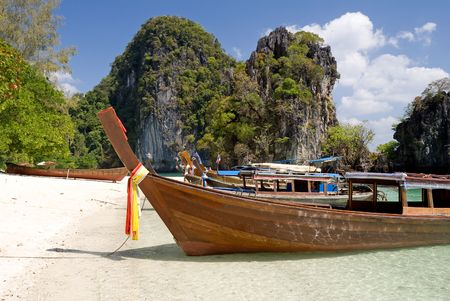 Traditional longtail boats on the beach of Hong island, Krabi province, Thailand  photo