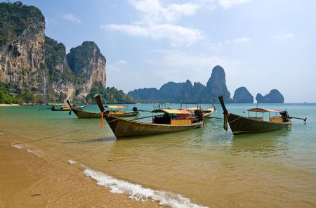 Traditional longtail boats on the Railay beach, Krabi province, Thailand Stock Photo - 4486899