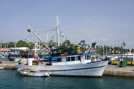 Fishing boat in the port of Vrsar, Istria, Croatia photo