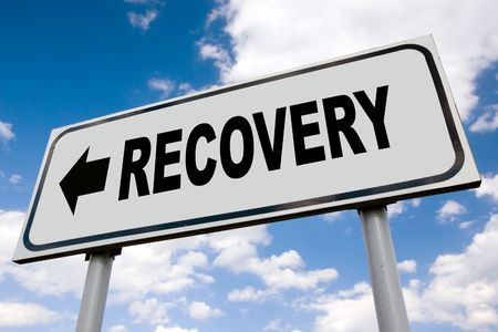 road to recovery: Economic recovery road sign