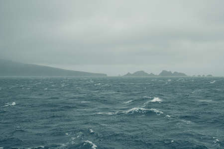 Winter 2019. Cape Horn, Drake Passage: Costa Cruise Vessel sailing through the southernmost point in Argentina / Chile. The captain and the officers from the Bridge Archivio Fotografico