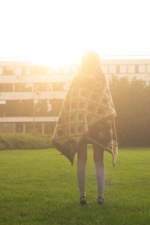 rear view girl: Rear view, girl standing strong  sunlight.