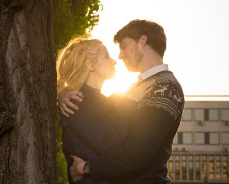 Couple heterosexual hug sunlight.