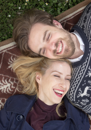 elevated view: Young adult, boy girl, laughing. Elevated view. Stock Photo