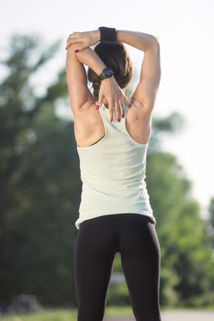 Girl, rear view stretch, arm.