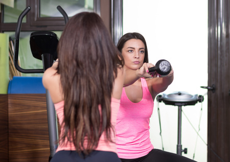 front view: two women front view exercise kettle bell.